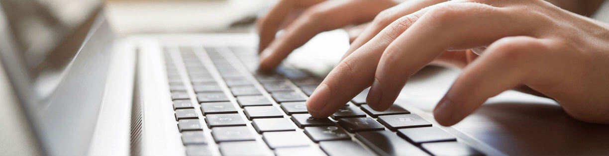 Person typing on keyboard - Wellers Law Group